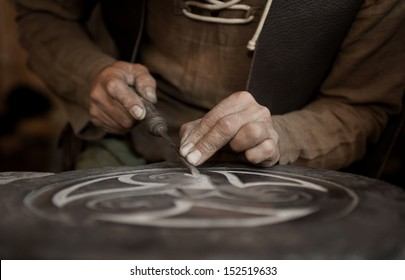 craftsman working on stone isolated on hands