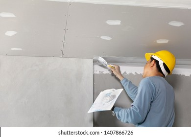 Craftsman working with plaster gypsum ceiling for interior build gypsum board ceiling