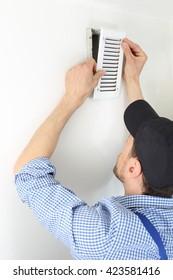 A Craftsmen changing a Ventilation filter 2
