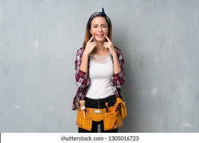 Craftsmen or electrician woman smiling with a happy and pleasant expression