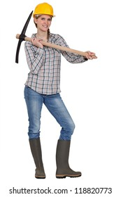 craftswoman holding a pick