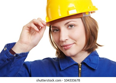 Craftswoman in overall putting on yellow safety helmet
