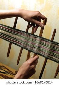 Craftswoman woman working her loom