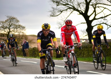 Cragg Road, Mytholmroyd, May 03 Tour De Yorkshire bike racers from teams Corfidis and JLT on May 03 2015 at Cragg Road, West Yorkshire.