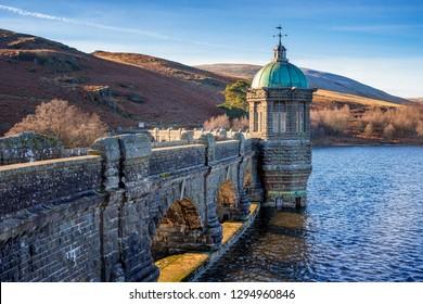 Craig Goch Dam, Elan Valley, Wales. Reservoir for Birmingham water supply with mountains in background