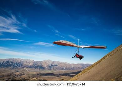 Craigieburn, Canterbury, New Zealand - May 2 2015: Hang gliding above the valley on a beautiful day