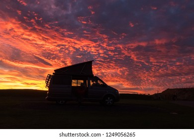 CRAIL, FIFE, SCOTLAND, UK - 24 OCTOBER 2018: VW Camper van during a brilliant sunset with dramatic skies - illustrative editorial