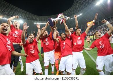 CRAIOVA, ROMANIA - MAY 14, 2018: Members of CFR Cluj soccer team celebrate winning the Romanian Supercup against Universitatea Craiova, on the Ion Oblemenco Stadium.