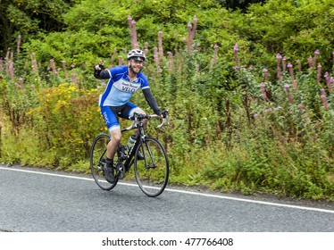 CRAMLINGTON, NORTHUMBERLAND, ENGLAND. AUGUST 28, 2016. Bicycle Riders take part in the Great North Bike Ride through Cramlington. August 28, 2016, Cramlington, Northumberland, England, UK.
