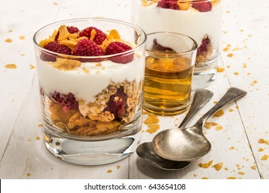 cranachan, a very scottish dessert made with corn flakes, raspberries, whisky and whipped cream in a glass