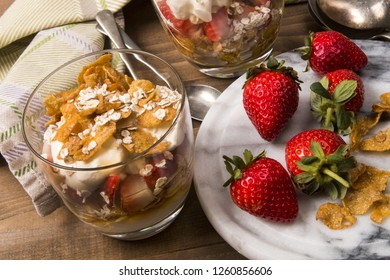 cranachan, a very traditional scottish dessert with strawberries, double cream, lightly roasted oatmeal and delicious scottish whiskey