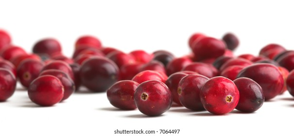 Cranberries against a white background