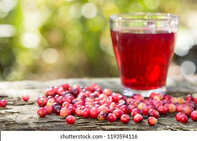 Cranberries and cranberry juice in a glass.