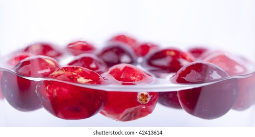 Cranberries floating in Water being washed before eating.