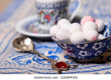 Cranberries in powdered sugar in a blue cup on the table