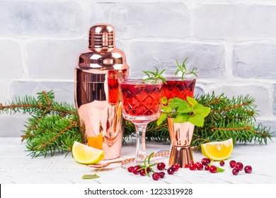 Cranberry coctail with mint, lime and rosemary. Christmas or new year party celebration concept. White background. Copy space