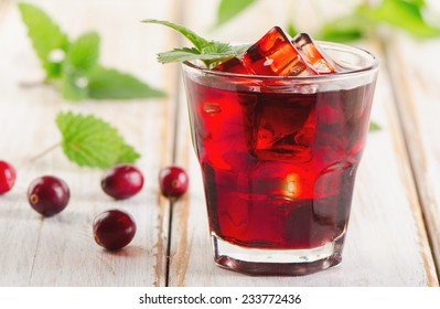 cranberry drink  on   a wooden background. Selective focus