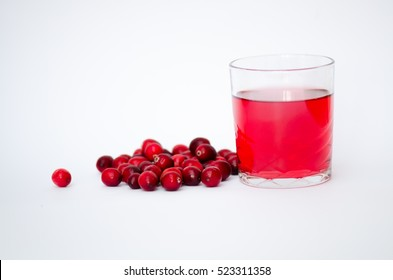 Cranberry fruit and juice on white background.