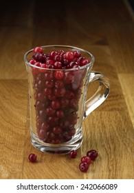 Cranberry glassy cup on the wooden table