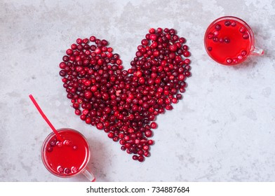 Cranberry mors with berries in a heart shape. from above. concept of health. healthy drink