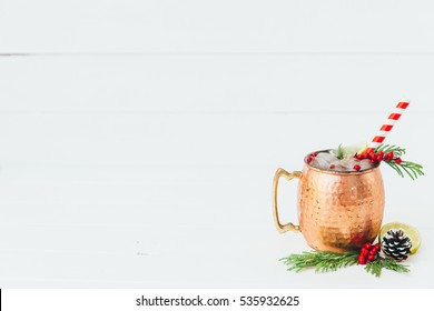 Cranberry Moscow Mule on Christmas holiday background, selective focus