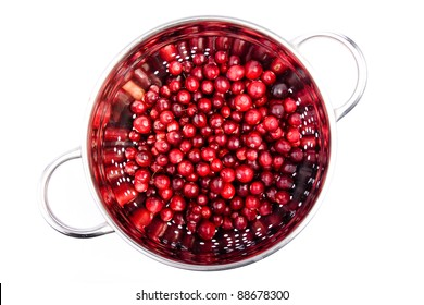 cranberry in the round colander made in studio isolated on white background