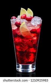 Cranberry vodka cocktail with ice cubes decorated with berries and lemon in highball glass isolated on black
