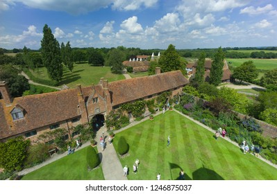 CRANBROOK, KENT, UNITED KINGDOM - July 31 2013: Tourists walking in the garden at Sissinghurst Castle, aerial view