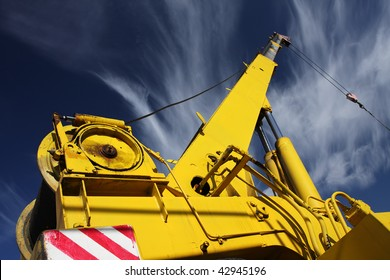 crane arm against a blue sky