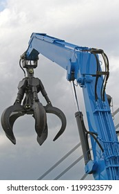 Crane Arm With Open Claw at Scrap Yard