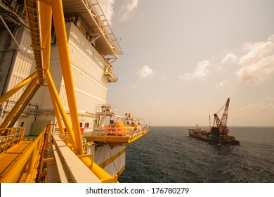 crane barge doing marine heavy lift installation works in the gulf or the sea