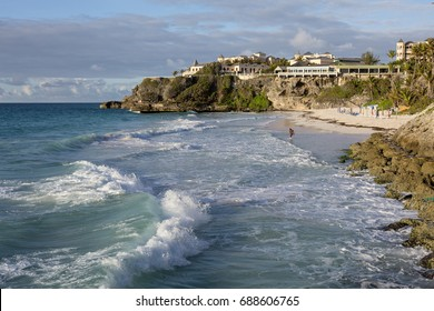 Crane Beach. On the east coast of Barbados is the public beach known as the Crane. While it faces the Atlantic Ocean, the sea is calmed by a natural coral reef making the beach quite safe to swim at.