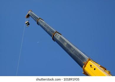 crane boom in the blue sky