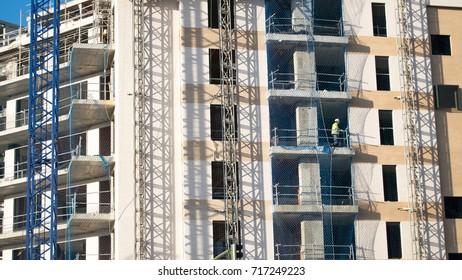 Crane, building under construction. Urban scene. Architecture.