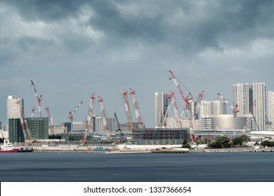 crane and buildings in a construction site in Tokyo city bay area