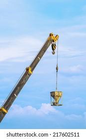 Crane and cargo with blue sky