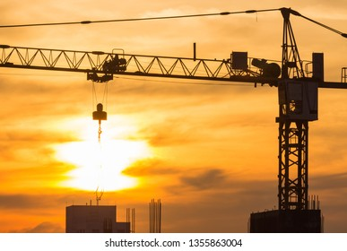 crane construction silhouette on sunset sky in the evening