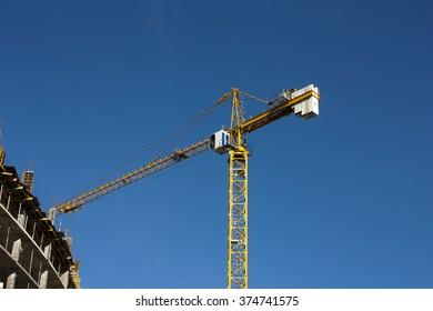 Crane  at construction site against blue sky