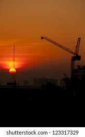 Crane in construction site at sunset