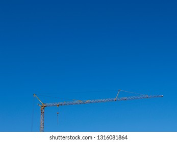 crane in front of a clear blue sky