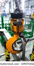 Crane hook hanging on steel ropes isolated in factory.