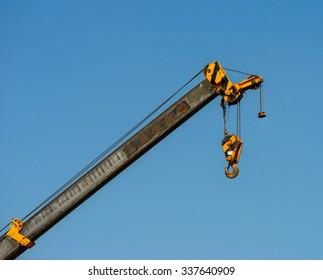 Crane hook on the blue skay