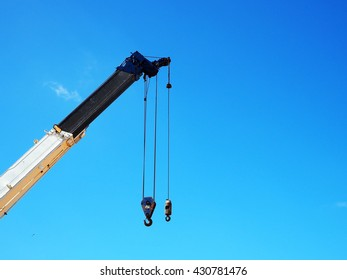 Crane hook on the blue sky