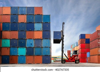 Crane lifting up container in yard - Shutterstock ID 402767335