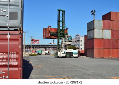 Crane lifting up container in yard, the Port of Tokyo, Japan
