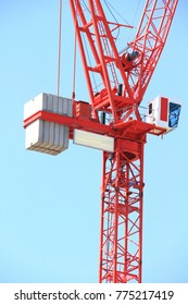crane lifting a heavy object on a building site