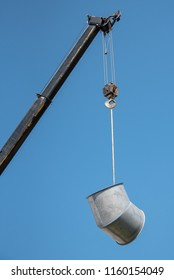 A crane lifting a large piece of air flow duct.