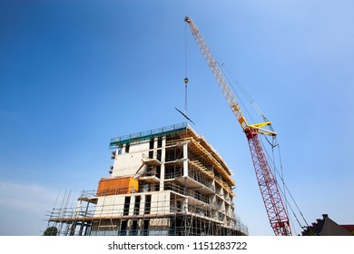 Crane lifting materials on a construction site of an apartment block in Lansingerland in the Netherlands