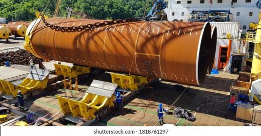 crane lifts a pile for offshore construction