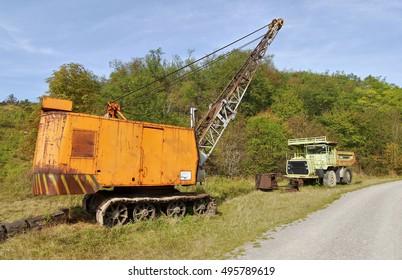Crane and mining truck. Historical crane and mining truck in the mining museum. Czech Karst, near Prague, Czech Republic. September 2016